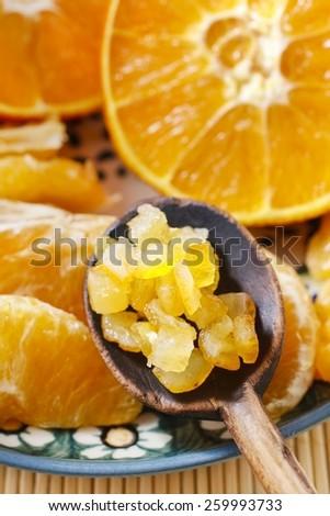 Candied orange peel and fresh juicy oranges