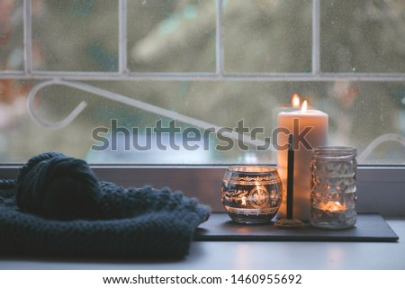 Candle and aroma stick on windowsill. Concept of relax, tranquil, peaceful, unplug, balanced time, Keep kalm and take it easy, knit leisure, meditation zen background