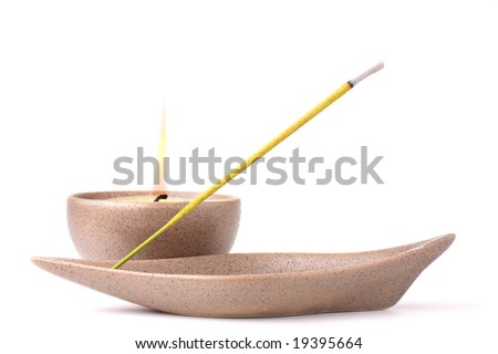 Candle and incense stick isolated on white background