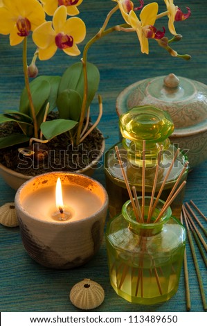 Candle and oil treatment equipment in relaxing spa scene.