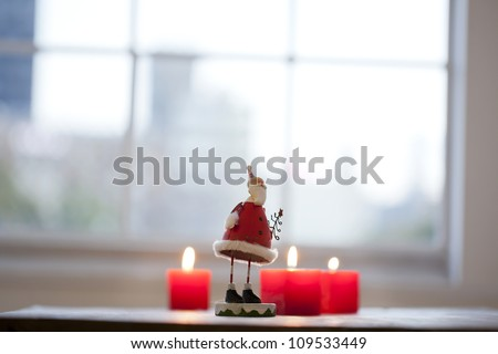 Candle and Santa Claus