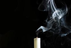 Candle and smoke extinguished Smoke Art on black background