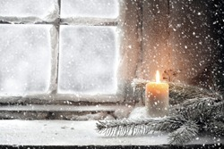 candle and snow
