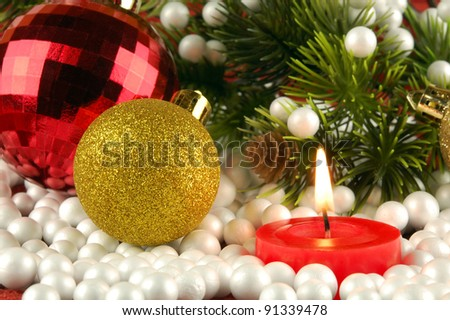 Candle, christmas decoration and artificial fir tree and snow from foam plastic as abstract festive background