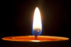 Candle fire on a black background.
