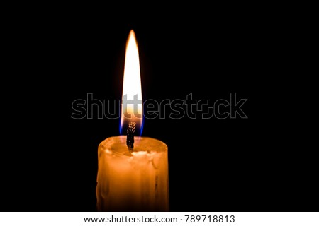Candle flame close up on a black background #789718813