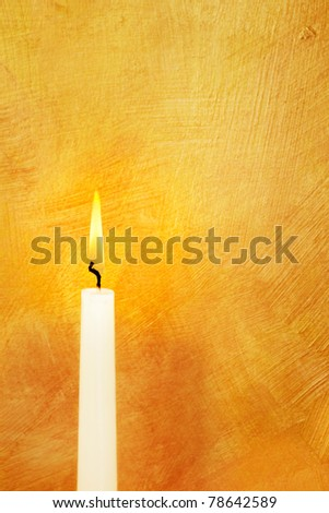 Candle flame lights hand painted gold background
