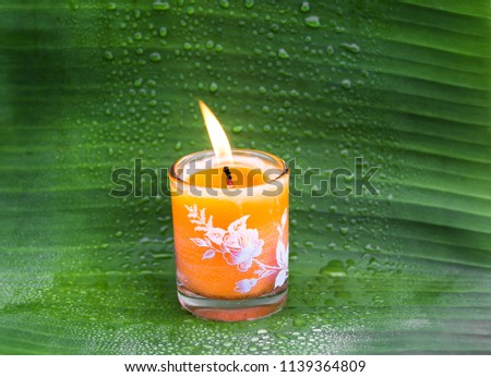 Candle for thai spa on banana green leaf background #1139364809