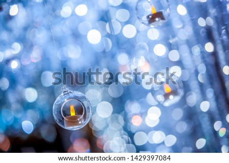Candle in a circle plastic ball with blur bokeh background #1429397084