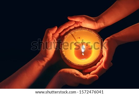 Candle in the hands blessing together