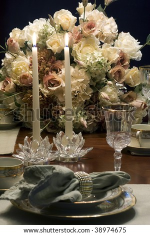 Candle Light dinner with flowers and table set romantically