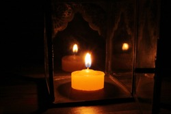 Candle light in the darkness and candle holder