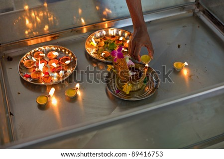 Candle offering on a hindu temple