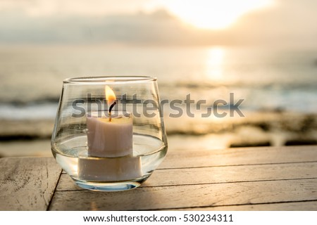 Candle on a table at sunset view cafe, Sunset Point, Nusa Lembongan, Indonesia