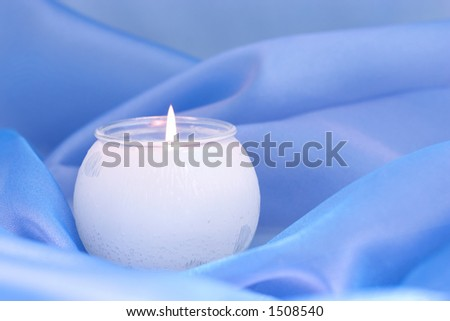 candle on blue