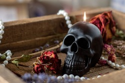 candle scull on witch table. Occult, esoteric, divination and wicca concept. Halloween, Day of the dead concept