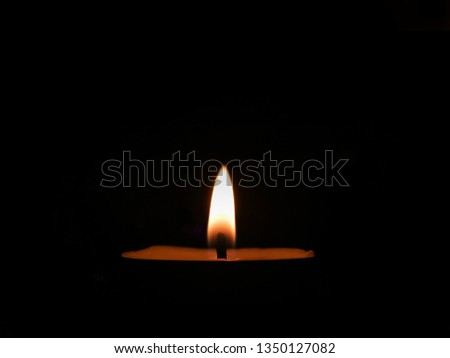 Candlelight in black background.candle flame in dark room. Calm concept.  #1350127082