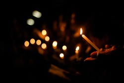 Candlelight with people. Bokeh of candles. And the crowd, community activities in the dark, reminiscence, inscriptions and hope for harm.