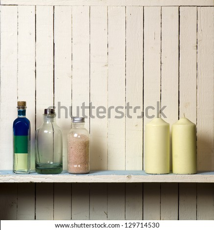Candles against rustic bathroom wall; good copy space