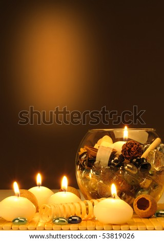 Candles and a set of the decorative stones, the flavored slices of a tree. Spa theme