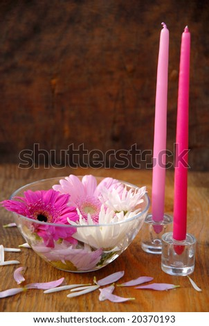 Candles and bowl with the flower