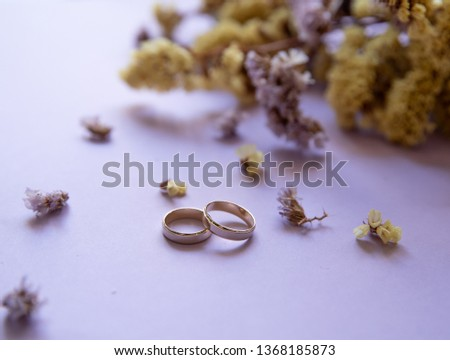 Candles and engagement ring, romantic atmosphere