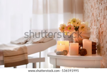 Candles and flowers for relaxation in wellness center #536591995