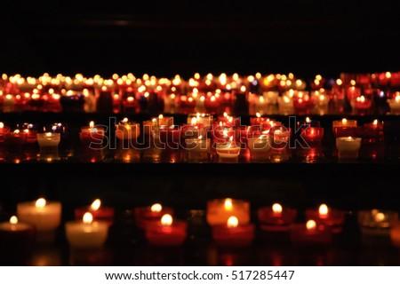 Candles in church. Selective focus. Bokeh.