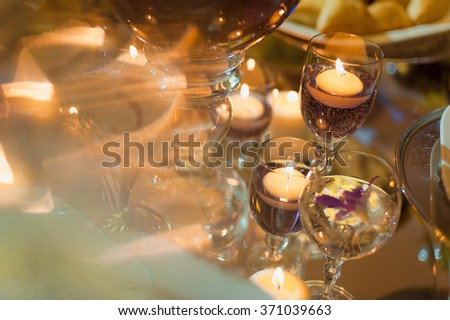 Candles in the glass #371039663