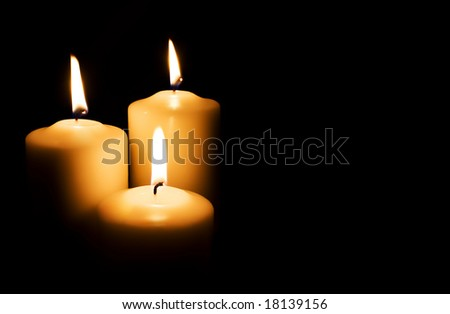 Candles isolated on black background