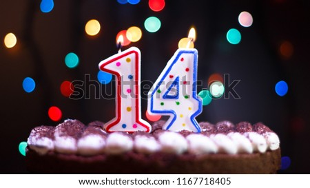 Candles on the cake. Happy Birthday. Fourteen years old. #1167718405