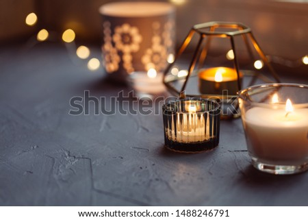 Candles on the windowsill. Cosy home concept