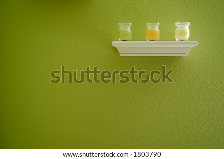 Candles on white shelf