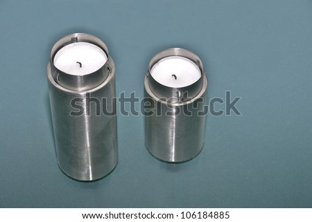 Candles over green background