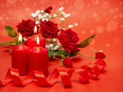 Candles, ribbon and beautiful flowers for the holiday. Festive concept for Valentine's Day, Mother's Day or Birthday