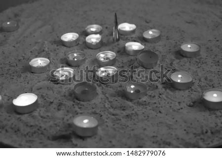 Candles some burning some extinguished