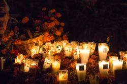 Candles with flowers in a mexican cemetery, day of the dead traditional celebration