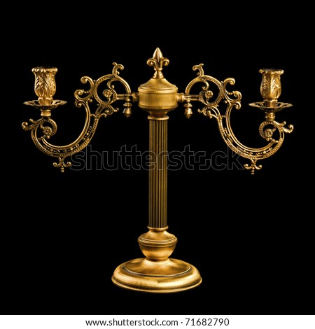 Candlestick in vintage style isolated on black background