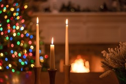 Candlesticks glowing on the table at Christmastime