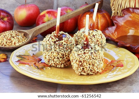 Candy apples with caramel sauce and a fresh ingredients in the background.