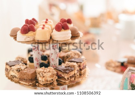 candy bar buffet with cake-stand design for luxury wedding or birthday. decorative dessert for garden party or holiday ornament