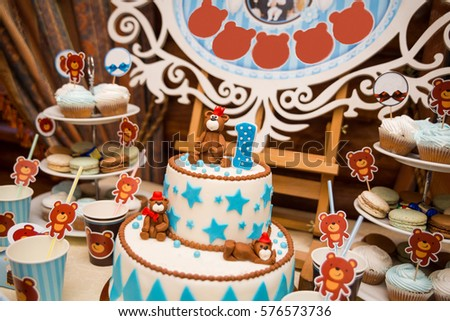 Candy Bar decorated by Delicious sweet buffet with cupcakes and other desserts/candies,happy birthday concept #576573736