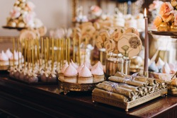 candy bar, sweets, sweets, chocolate, lollipops, cakes and macaroons are laid out on beautiful trays and decorated with flower arrangements