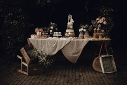 Candy bar with wedding cake, rustic table