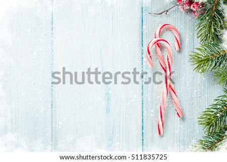Candy cane and christmas tree on wooden table. Top view with copy space #511835725