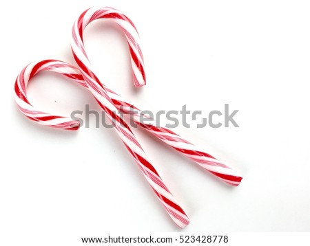 Candy canes on a white surface