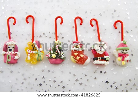 Candy canes with different figures on a background with stars