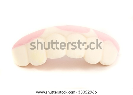 candy denture on white background