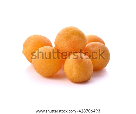 Candy has a nickname called turtle eggs or quail eggs as snacks , appetizers of Thailand . Isolated on white background . Often served with fried banana . #428706493