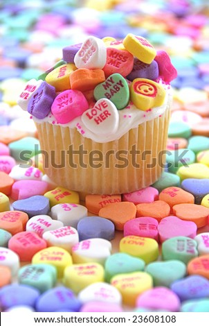 Candy Heart Cupcake surrounded by colorful candy hearts